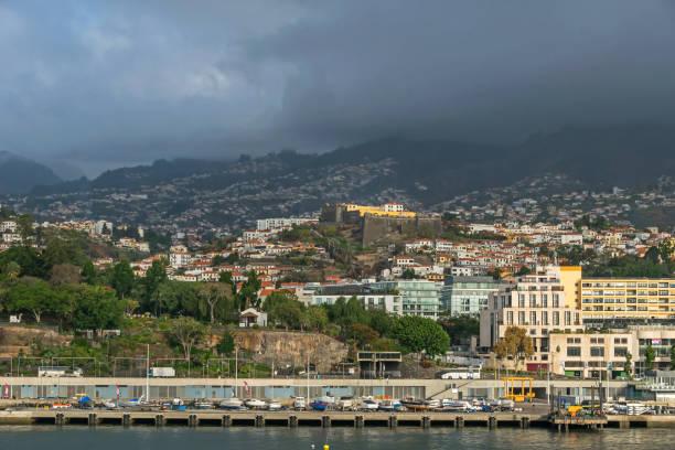 avenida sá carneiro, santa catarina park and pico fort in funchal, madeira - rain clouds porto portugal imagens e fotografias de stock
