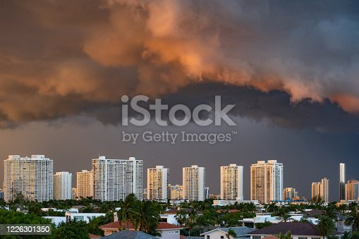 This is a photograph of residential high rise apartment buildings with dark tropical storm clouds in Aventura, Florida at the beginning of hurricane season.