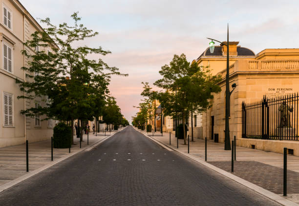 Avenue Champagne Epernay Sunset Epernay: Avenue de Champagne with several Champagne houses along the road during sunset in Epernay, France. epernay stock pictures, royalty-free photos & images