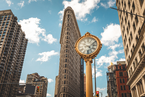 5TH Avenue clock with the Flatiron Building in the background