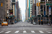 Manhattan, New York, USA - April 5, 2020: the empty streets in midtown Manhattan is due to New Yorkers practicing sel-isolation and social distancing by a stay at home order to prevent the spread on Covid-19, the coronavirus pandemic.
