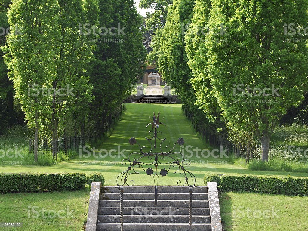 Avenue of trees in English Country Garden royalty-free stock photo