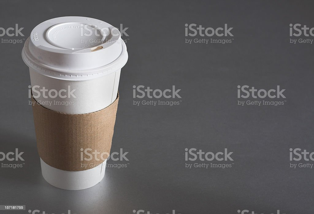 Average coffee cup with blank sleeve to advertise coffee stock photo