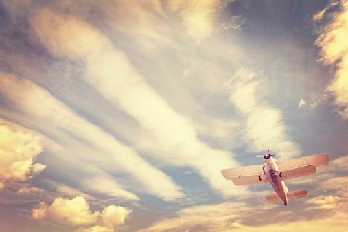 Aviation Instagram, old low-flying airplane against moody sky, retro look