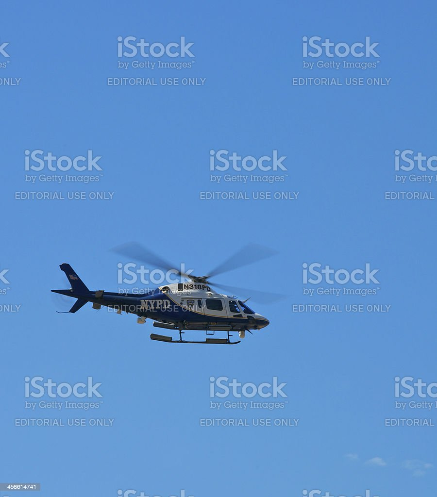 NYPD Aviation Unit helicopter against blue sky, NYC royalty-free stock photo