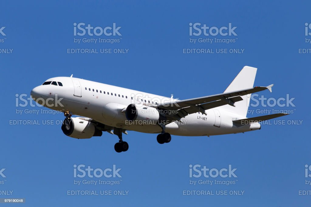 LY-VET Avion Express Airbus A319-100 aircraft on the blue sky background stock photo