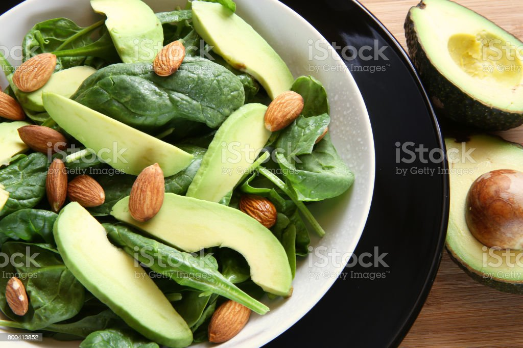 avocado almonds spinach salad stock photo