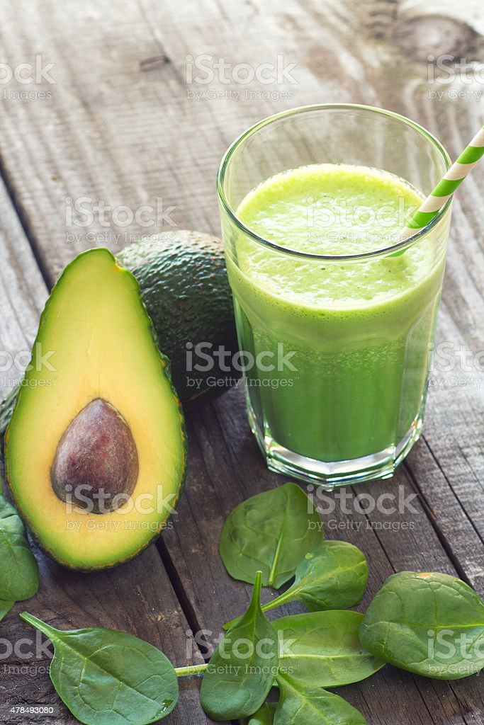 Avocado and baby spinach smoothie stock photo