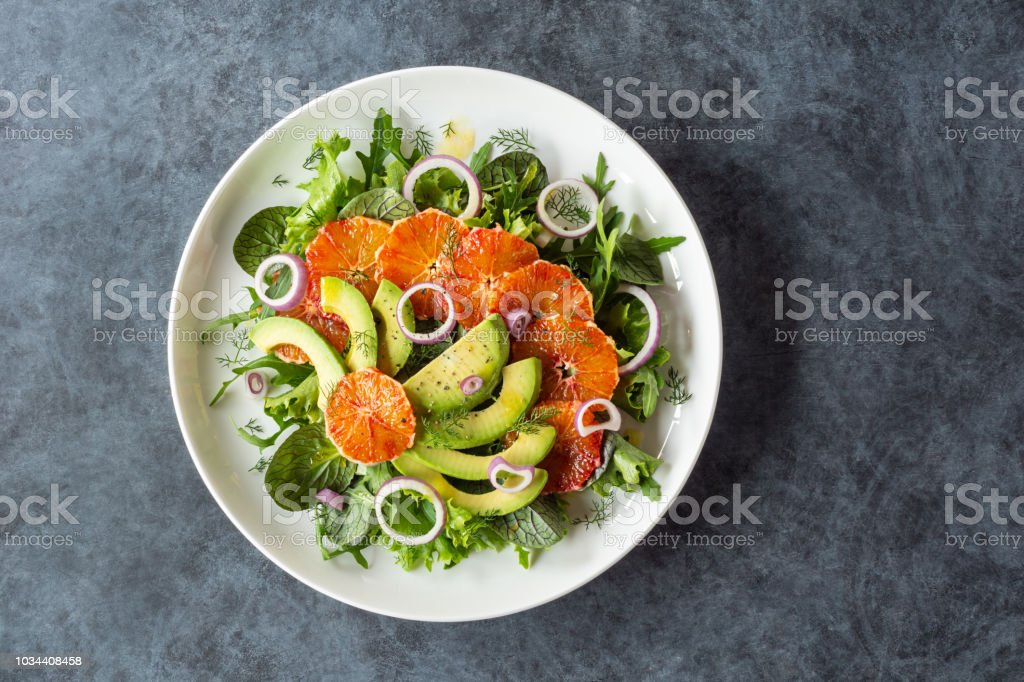 Avocado and Blood Orange Salad with Fennel Over Mixed Greens stock photo