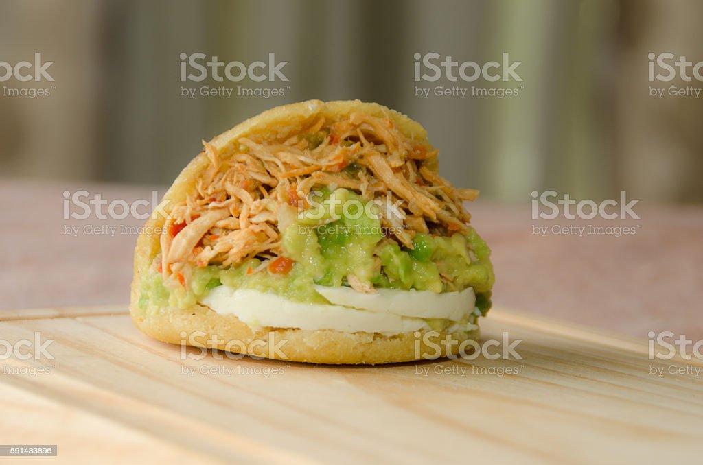 Avocado and chiken arepa stock photo