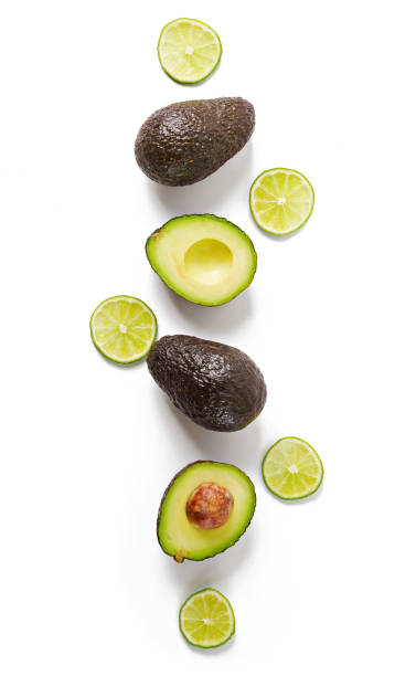 Avocado and lime isolated on white background. Top view stock photo