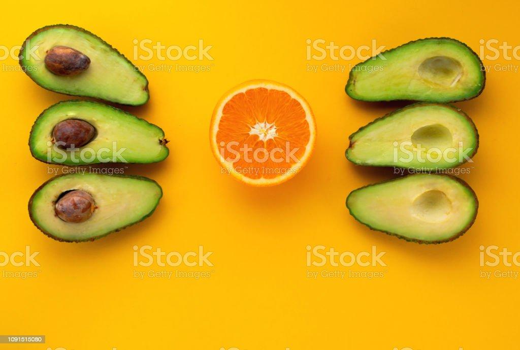 avocado and orange fruit stock photo