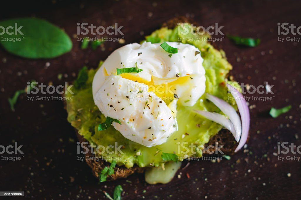 Avocado and poached egg sandwich, close up stock photo