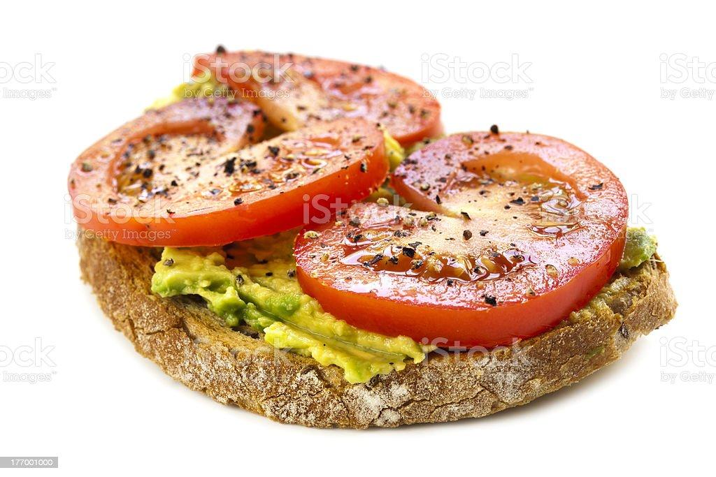 Avocado and Tomato Open Sandwich over White stock photo