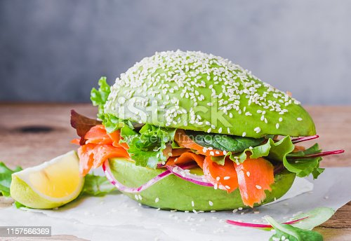 Avocado burger with salmon healthy raw food lunch.