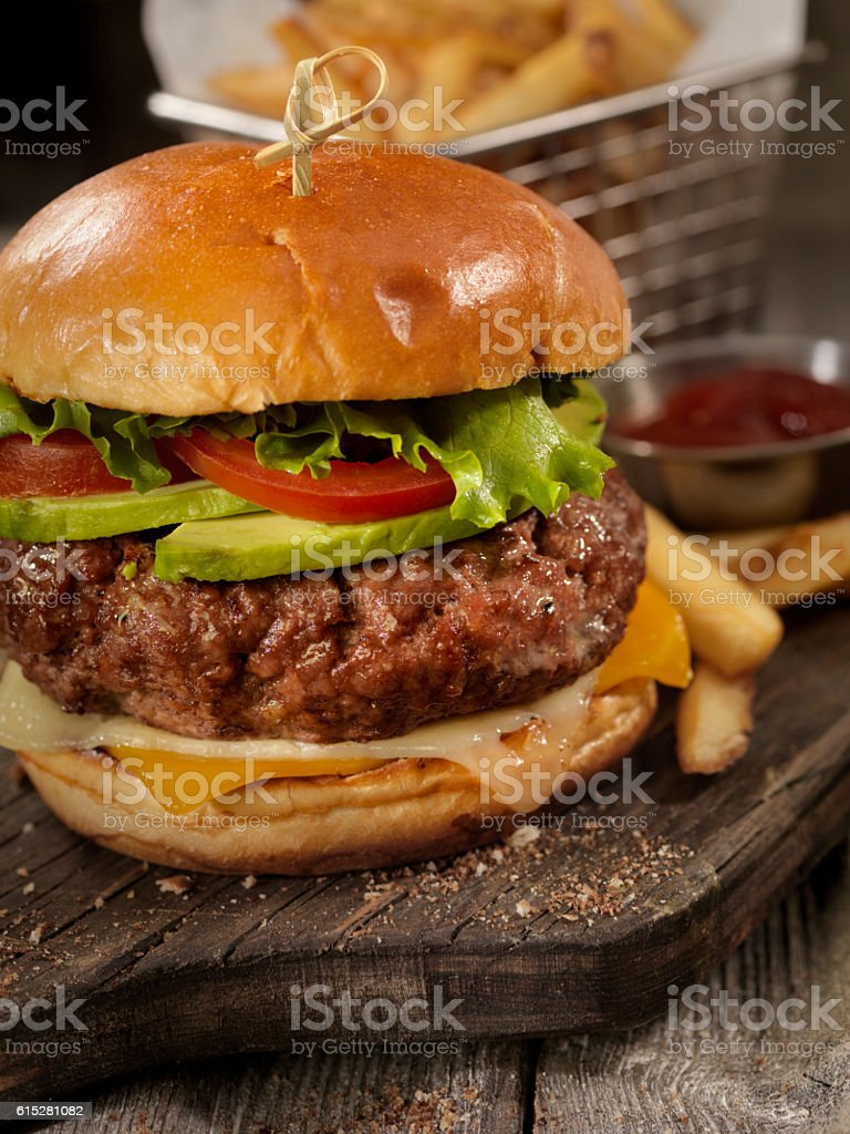 Avocado Cheeseburger with a Basket of Fries stock photo
