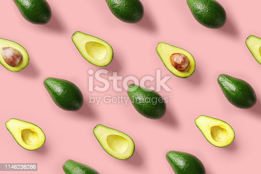 Avocado colorful pattern on a pastel pink background. Summer concept. Flat lay.