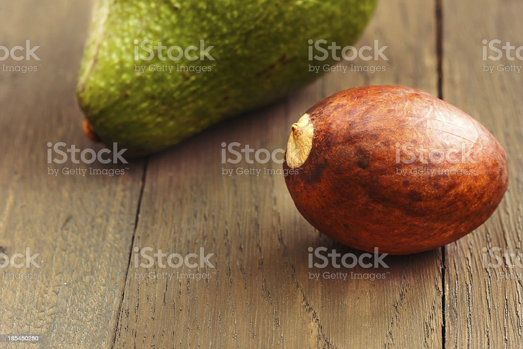 Avocado core on brown wooden old table royalty-free stock photo