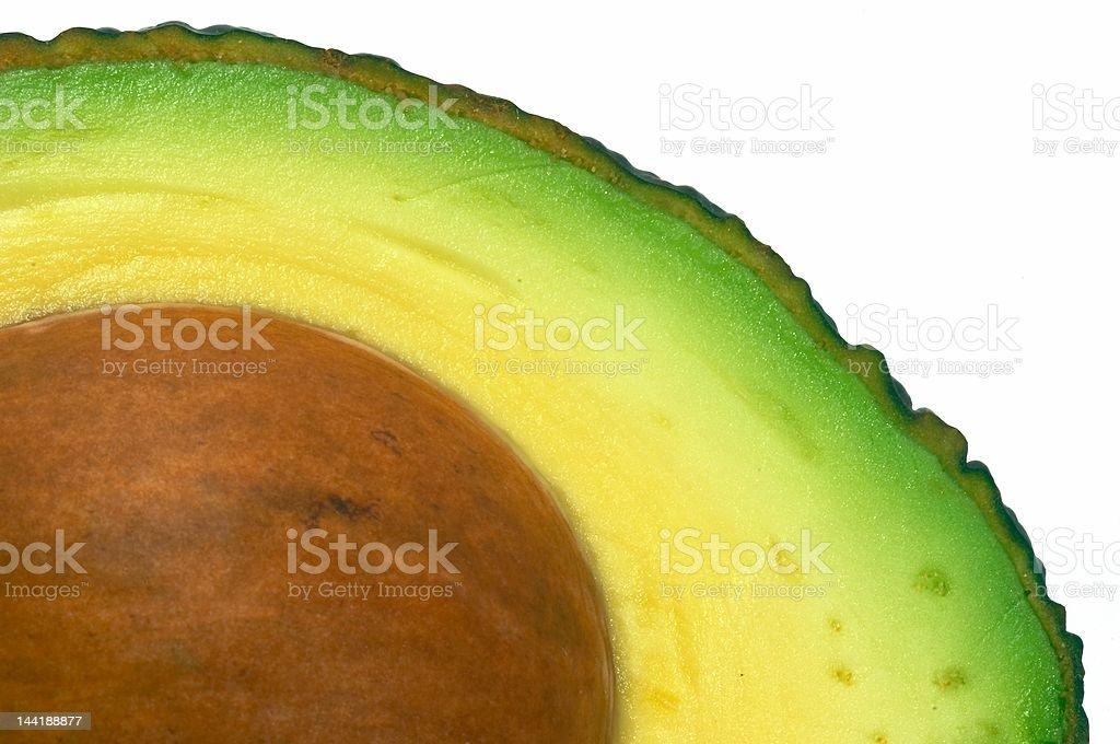 Avocado cut closeup, macro isolated royalty-free stock photo