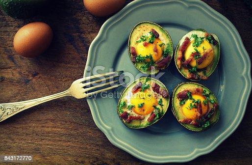 istock Avocado Egg Boats with bacon . Top view 843172770