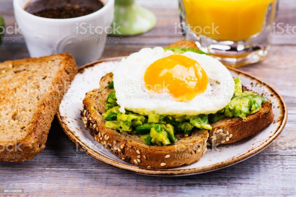 Avocado egg sandwich with whole grain bread stock photo