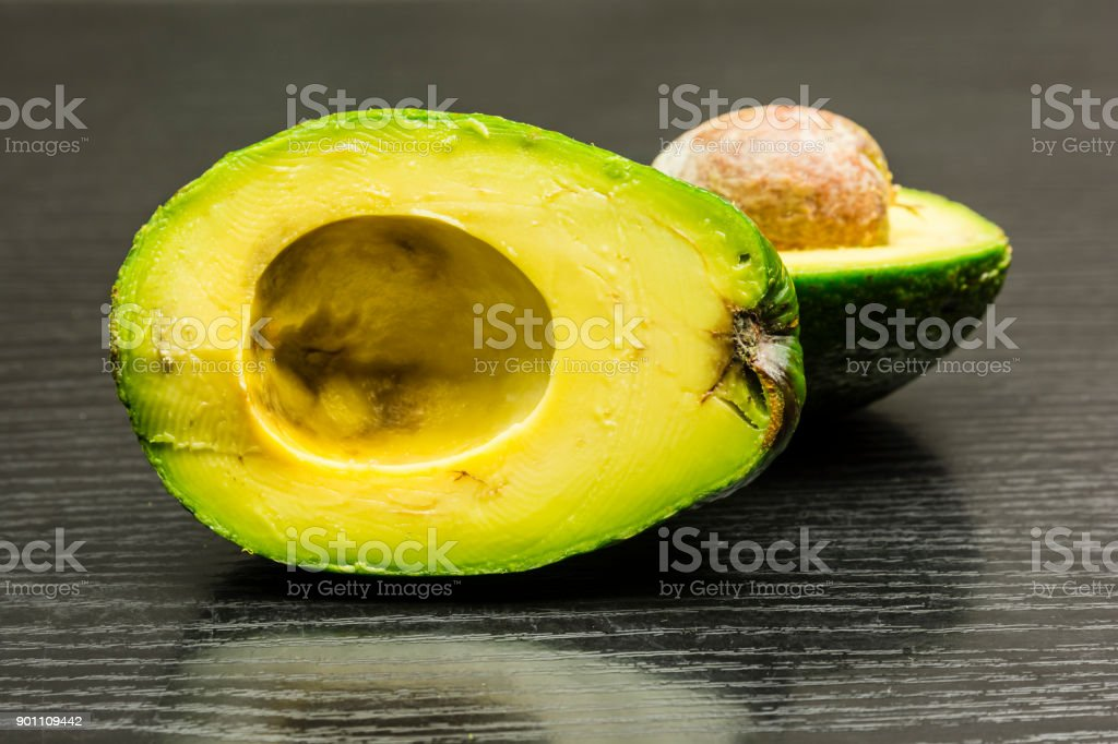 Avocado fruit in section. stock photo