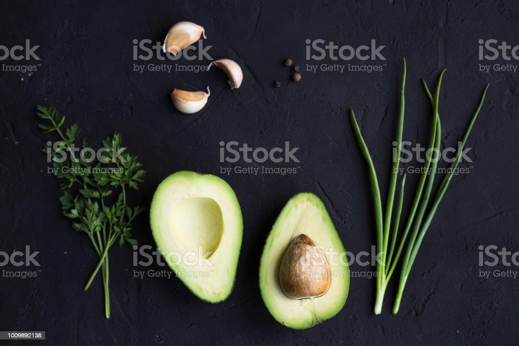 Avocado fruit on a black background stock photo