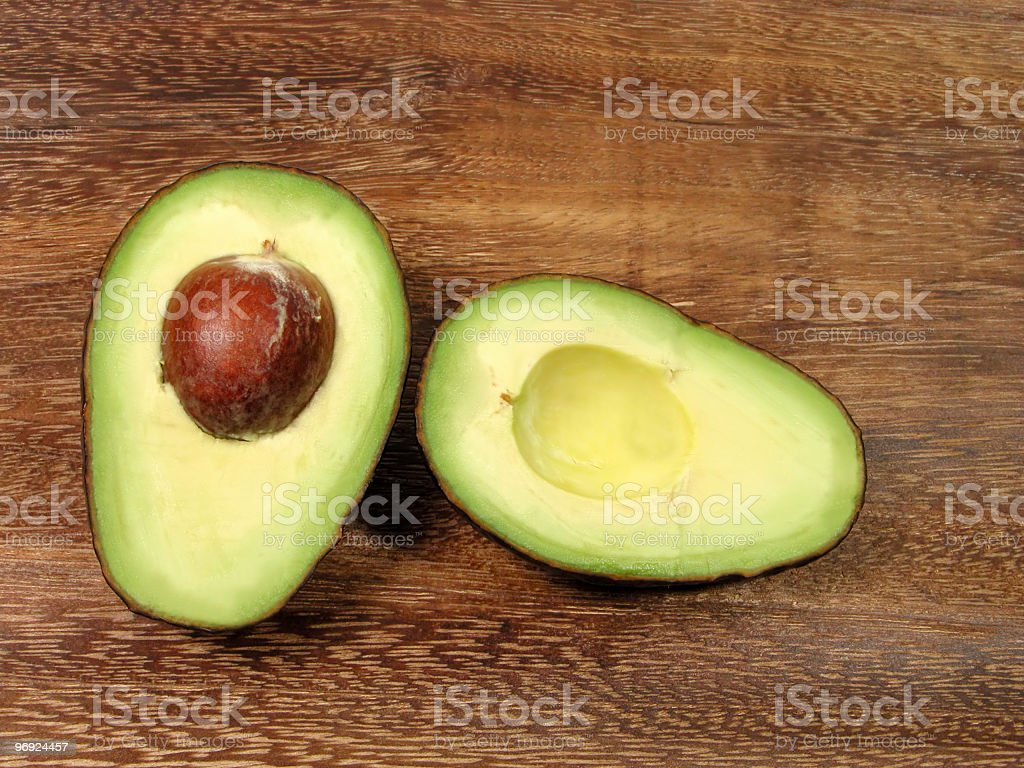 Avocado halves royalty-free stock photo