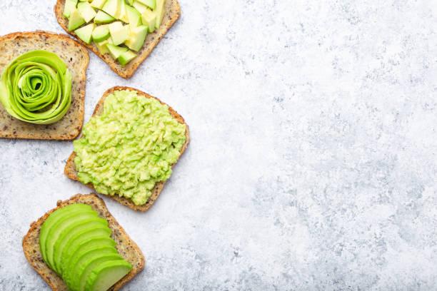 Avocado healthy  toasts stock photo