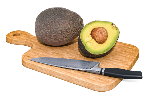 istock Avocado lies on a wooden board next to a knife, 3D rendering isolated on white background 1183184762
