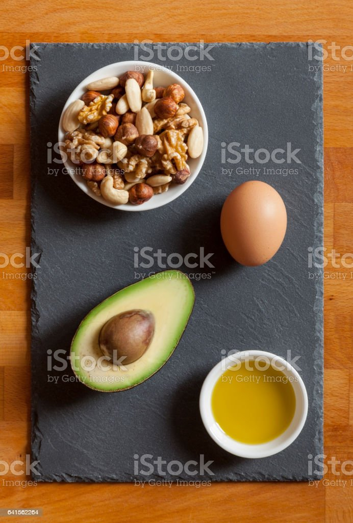 Avocado, Mixed nuts, Olive Oil and Egg on Table Top stock photo