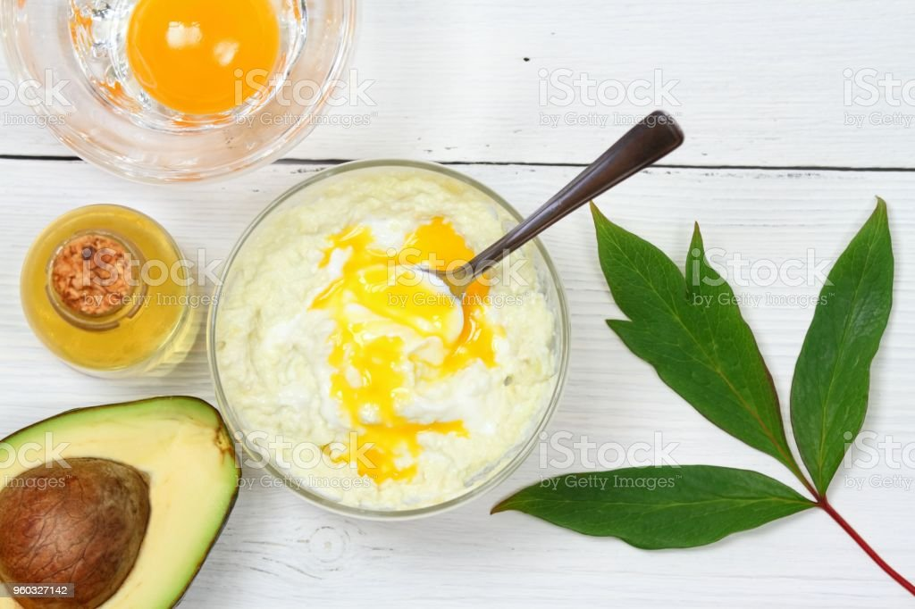Avocado, olive oil, yogurt and egg yolk for hair mask stock photo