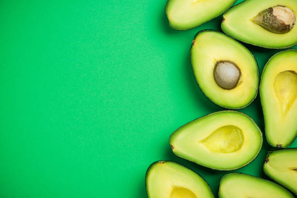 Avocado on pastel background,creative food concept stock photo