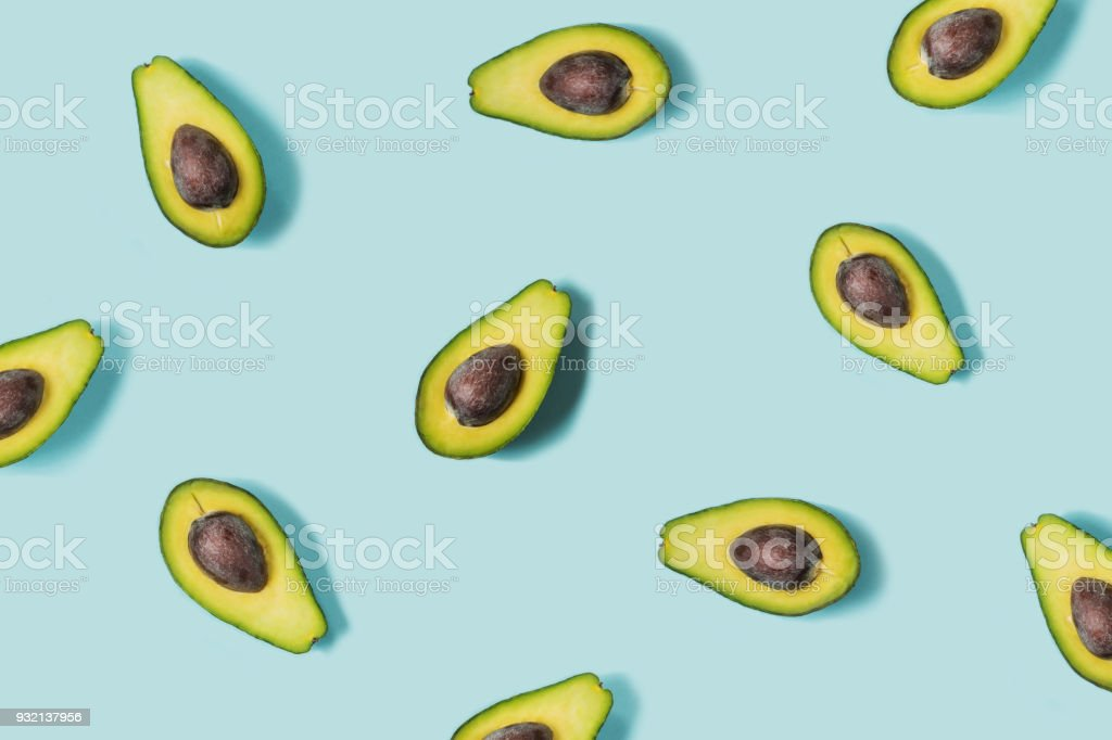 Avocado on the blue background. Top view royalty-free stock photo