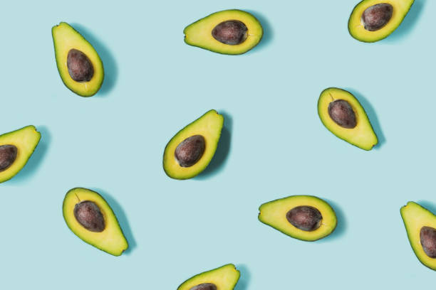 Avocado on the blue background. Top view stock photo