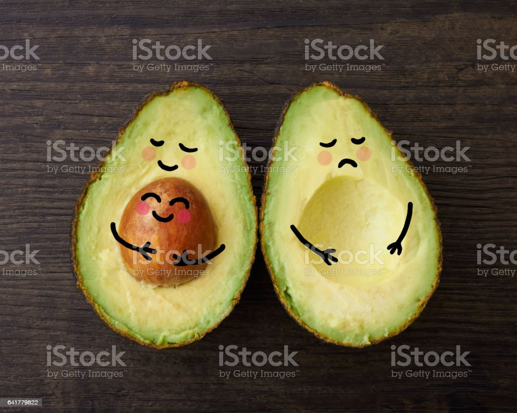 Avocado parent with a baby and one without stock photo