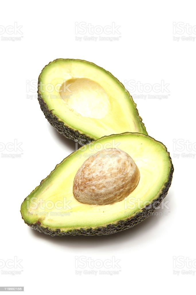 Avocado pear halved on a white background. stock photo