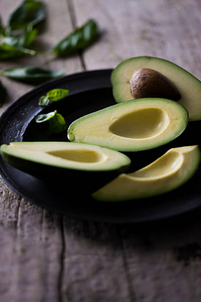 avocado - kelly green stock pictures, royalty-free photos & images
