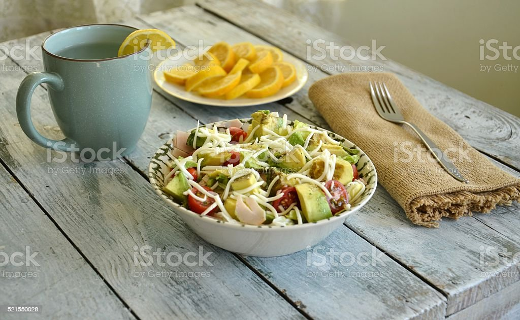 Avocado Salad with Lemon Water and Slices stock photo