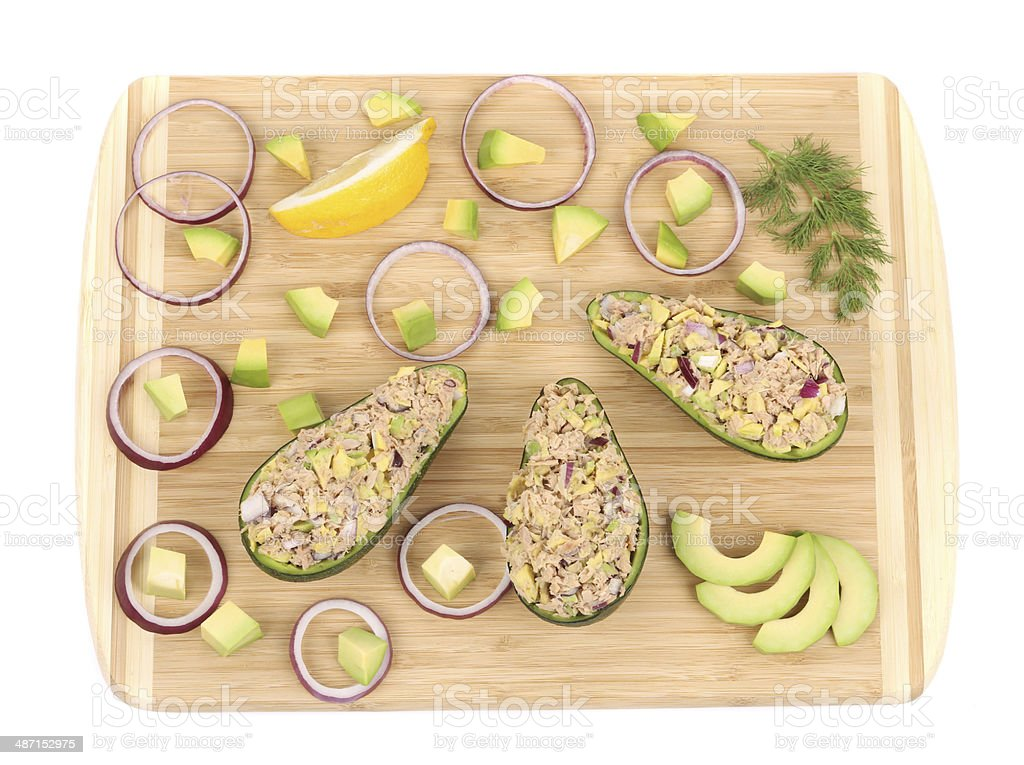 Avocado salad with tuna on cutting board. royalty-free stock photo