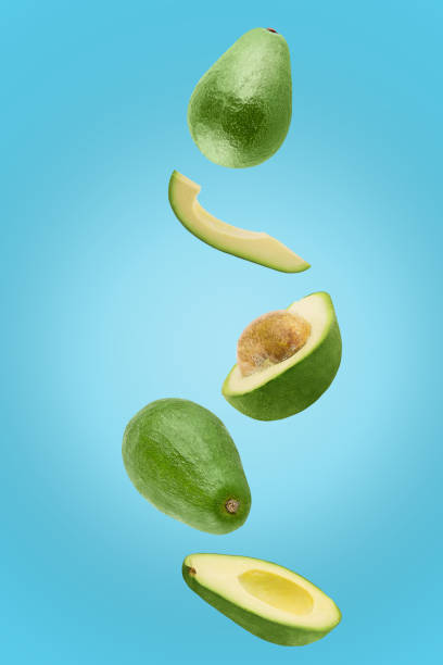 Avocado sliced isolated in blue background viewed from above stock photo