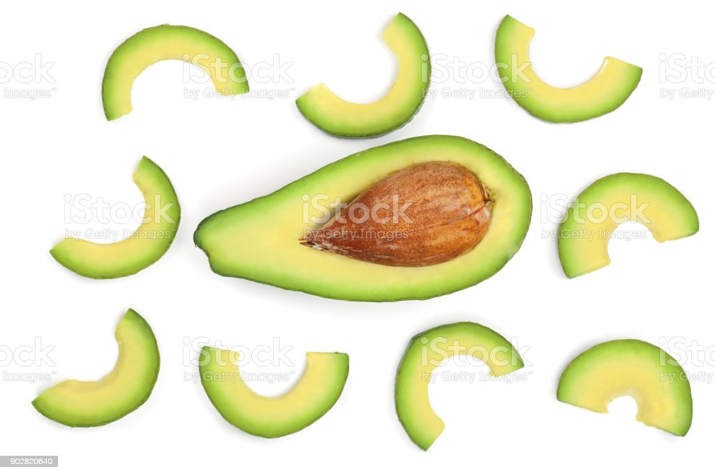 avocado slices isolated on white background. Top view. Flat lay pattern stock photo