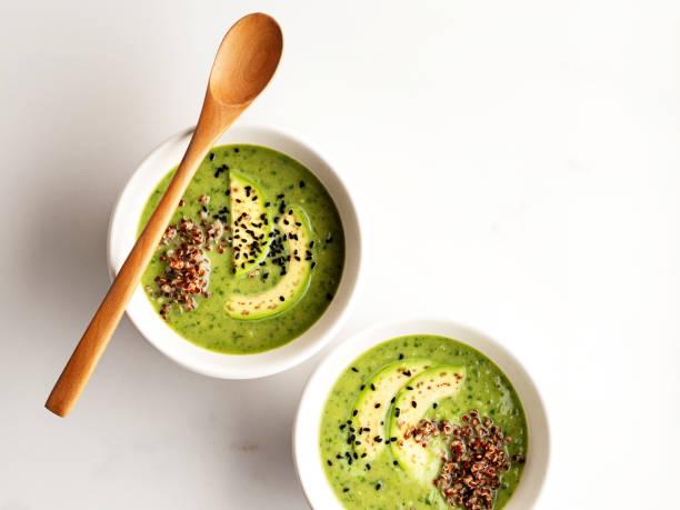 avocado soup,quinoa and avocado soup,spinach soup with avocado stock photo
