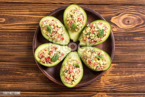 istock Avocado stuffed with cucumber , tomatoes and eggs 1001621596