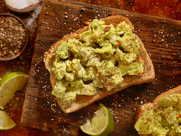 avocado toast - mash food state stock photos and pictures