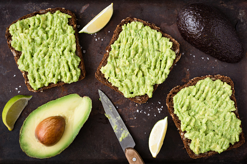 Avocado toast with whole grain rye bread. Top view