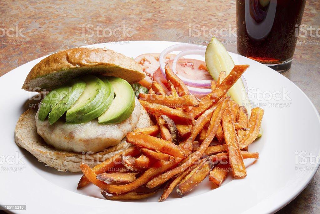 Avocado Turkey Cheeseburger and Fries stock photo