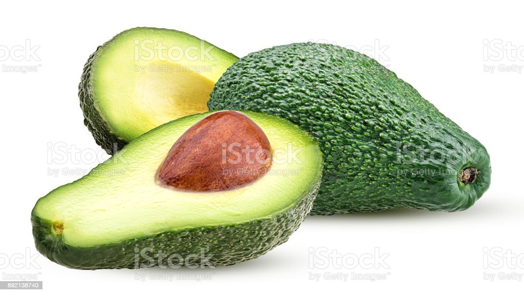 Avocado whole and cut in half with bone stock photo