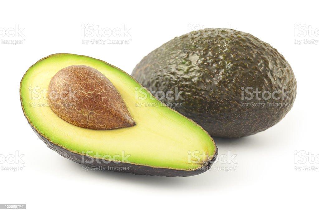 Avocado, whole and half stock photo