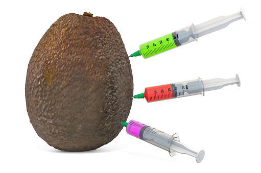 istock Avocado with a syringes full of chemicals. Genetic Food Modification, concept. 3D rendering isolated on white background 1182713020